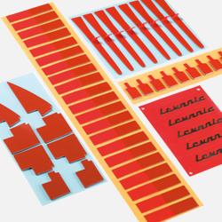 Vista de varios troquelados autoadhesivos de cintas de doble cara 3M realizados en la planta de troquelados de Fustier