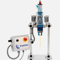 Vista de un dosificador de adhesivos líquidos comercializado por Fustier
